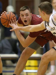 FILE – Danville's Alec Burton scored a game-high 30 points in Saturday's sectional title win over Beech Grove.