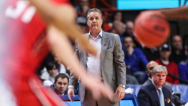 """Kentucky's John Calipari watches his team compete against Davidson Thursday at the first round NCAA Regional in Boise.  """"You've got to play 40 minutes and fight like heck and then go back to the hotel room and pass out,"""" Calipari said after the Wildcats' win over Davidson. March 15, 2018"""