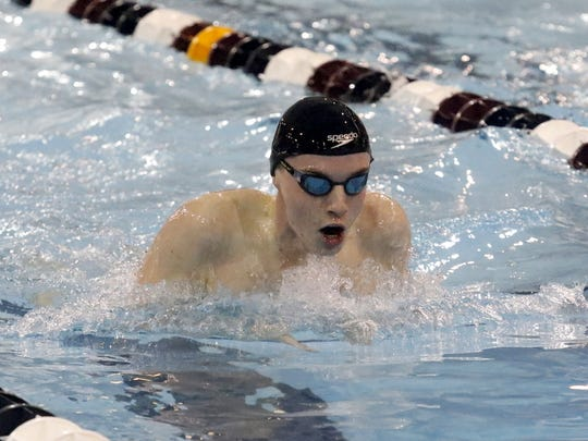 Karl Grunder of Chenango Valley swims to a victory in the 100-yard breaststroke Saturday at the John Beecher Boys Swimming and Diving Invitational at Ernie Davis Academy.