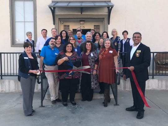 Caprock Home Health celebrated its move to 215 S. Irving St. during an open house event on Nov. 16.   Patty Maciel joined owner Martha Morales with the ceremonial scissors as local dignitaries and associates helped them cut the ribbon.