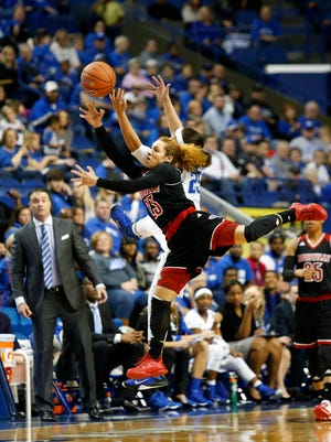 Louisville's Briahanna Jackson (#23) and Kentucky's Makayla Epps go up high to battle for the ball. Dec. 10, 2015
