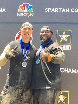 Spartan Race competitors pastor John Powell, left, and Parkview Learning Center special education teacher Chris Morris have been friends since childhood.