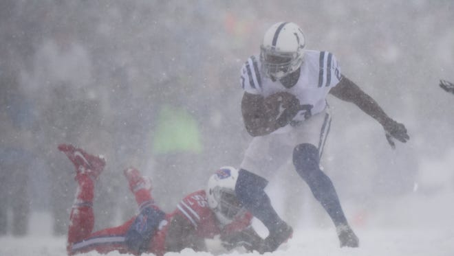 Dec 10, 2017; Orchard Park, NY, USA; Indianapolis Colts running back Frank Gore (23) runs with the ball past Buffalo Bills defensive end Jerry Hughes (55) during the first quarter at New Era Field. Mandatory Credit: Rich Barnes-USA TODAY Sports