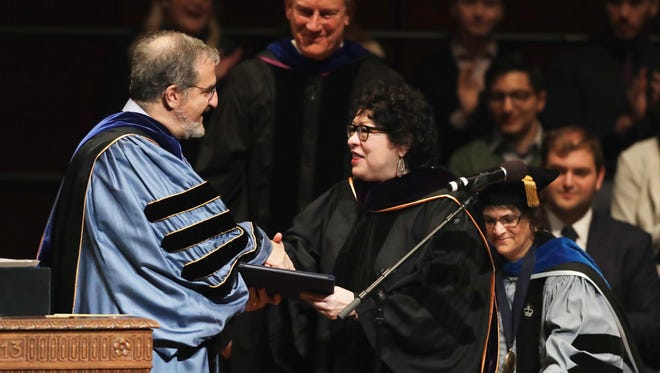 University of Michigan President Mark Schlissel presents Supreme Court Justice Sonia Sotomayor, a Doctor of Laws degree, Monday, Jan. 30, 2017, during a ceremony at the university in Ann Arbor, Mich.