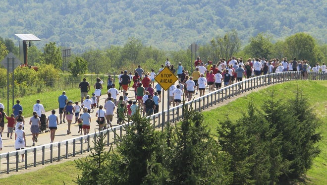 Runners spread out along Lowe Road in Big Flats during a past Time to Sperr memorial race in honor of slain state Trooper Andrew J. Sperr