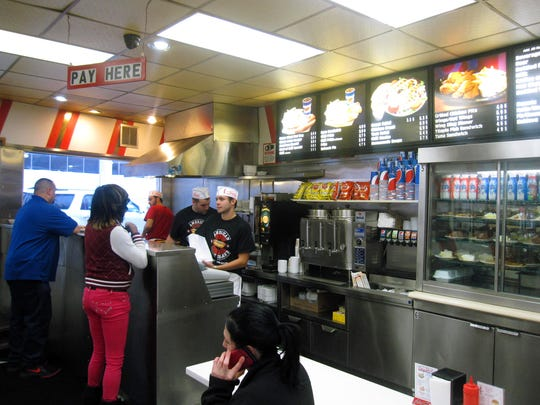 This Dec. 2, 2014 photo shows the interior of American Coney Island in Detroit. The eatery is known for Coney Island-style hot dogs, which are served with onions, mustard and chili. American was founded by current owner Grace Keros' grandfather, a Greek immigrant, in the early 20th century. A rival eatery, Lafayette Coney Island, is located next door and many locals swear allegiance to one or the other. (AP Photo/Beth J. Harpaz)