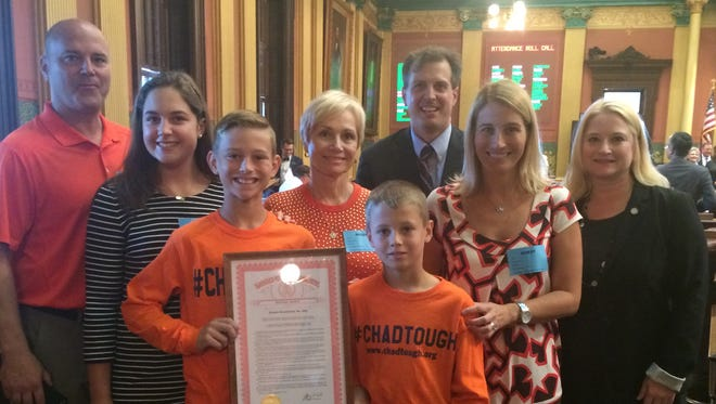 Chad Carr's family visits the state of Michigan legislature on Sept. 22, 2016