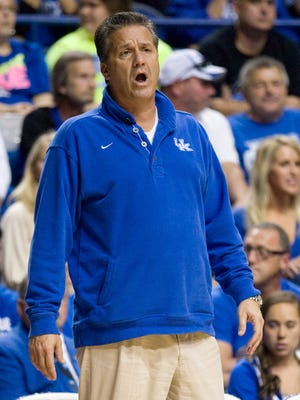 Kentucky Wildcats head coach John Calipari gives instructions to his team during the Kentucky Blue-White Scrimmage at Rupp Arena.