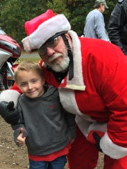 Santa and Garrett Kring give thumbs up for the 19th