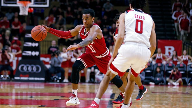 Indiana guard Devonte Green (11) drives to the basket past Rutgers guard Geo Baker (0) during the first half of an NCAA college basketball game Monday, Feb. 5, 2018, in Piscataway, N.J.