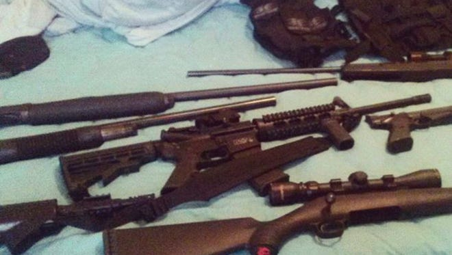 This photo posted on the Instagram account of Nikolas Cruz shows weapons lying on a bed. Cruz was charged with 17 counts of premeditated murder on Thursday, Feb. 15, 2018, the day after opening fire with a semi-automatic weapon in the Marjory Stoneman Douglas High School in Parkland, Fla. (Instagram via AP)