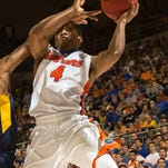 Florida guard KeVaughn Allen is fouled on a layup attempt against West Virginia on Jan. 30 in Gainesville.
