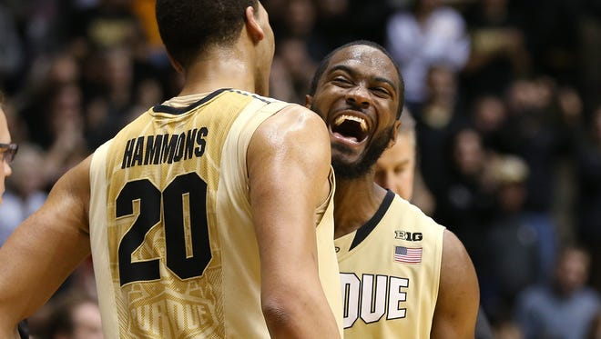 Purdue Boilermakers guard Rapheal Davis and teammate A.J. Hammons celebrate a win over Indiana, January 28, 2015.