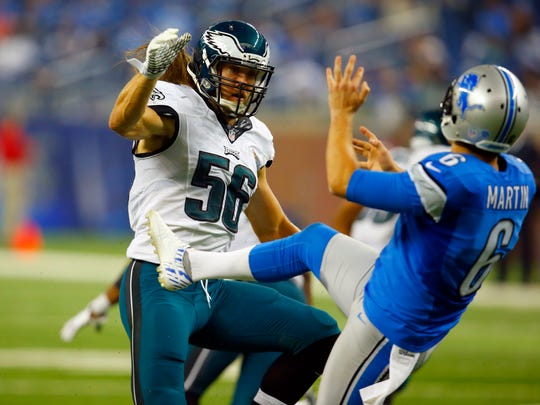 Philadelphia Eagles linebacker Bryan Braman, left, tries to block a punt by the Detroit Lions' Sam Martin on Nov. 26, 2015, in Detroit.