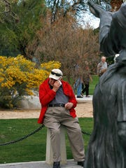 Holocaust survivor Leo Mittler is overcome with emotion as he looks at a sculpture of a woman and child at the Holocaust Memorial in Palm Desert during a past observance in Palm Desert.