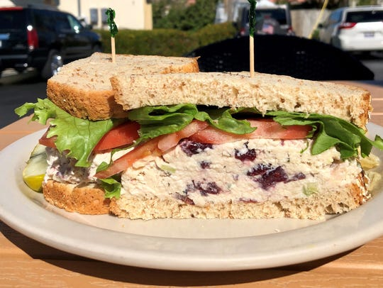 A chicken salad sandwich on seven-grain bread at NeNe's