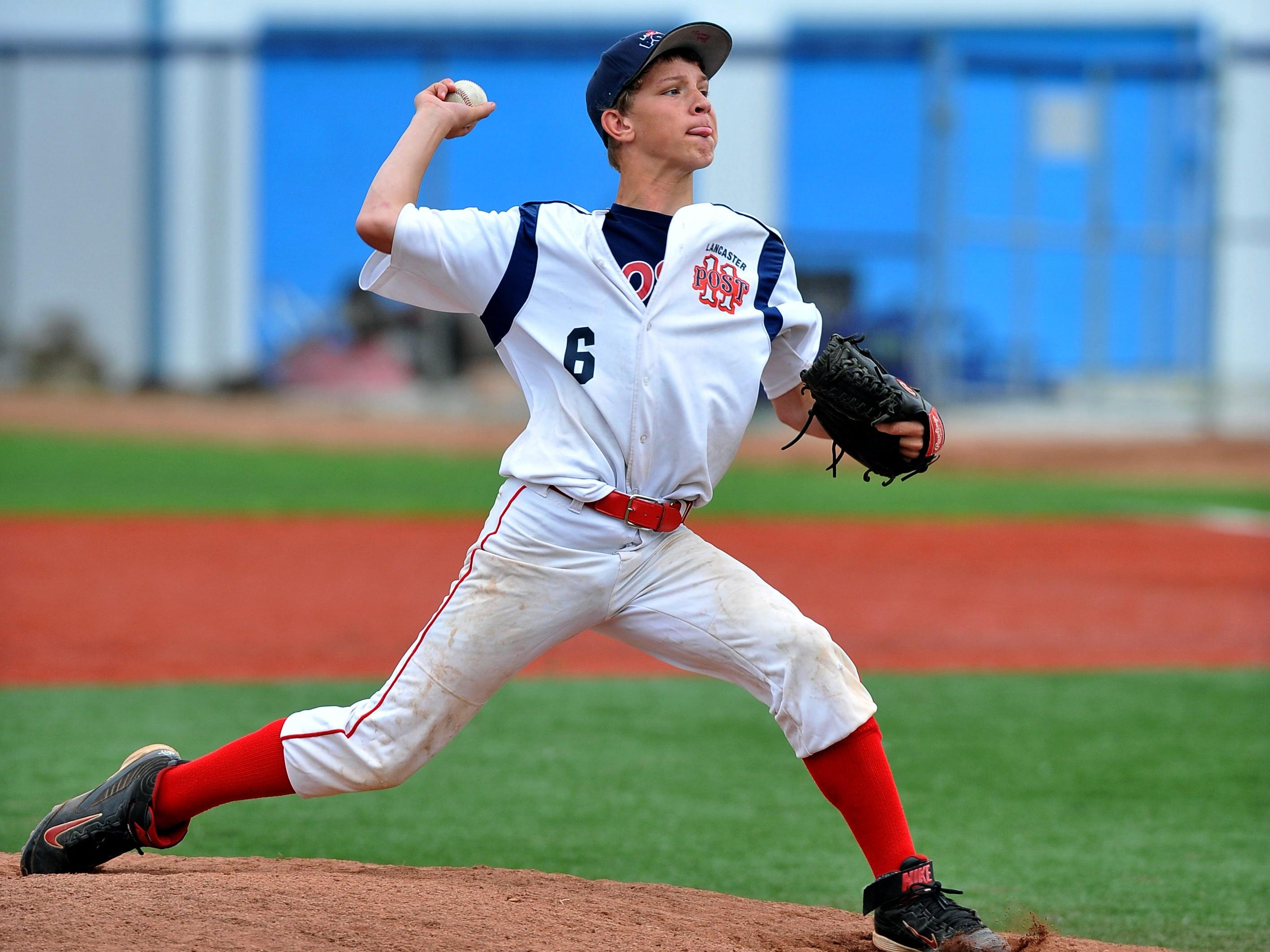 Noah Rossiter pitches during the Lancaster Post 11 Junior team's game against the Utica Post 92 Junior team Wednesday night at Beavers Field in Lancaster. Post 11 lost the game 9-7.