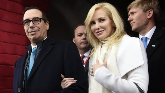 Treasury Secretary Steve Mnuchin and Louise Linton arrive on Capitol Hill in Washington in this file photo.