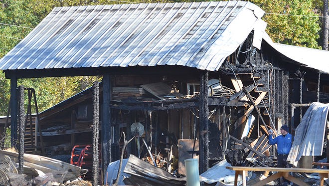 An investigator works the scene of last Thursday's fire at the Mississippi Agriculture and Forestry Museum on Lakeland Drive in Jackson.