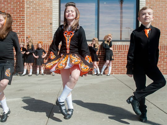 Students of Broesler School of Irish Dance in Haddonfield perform a traditional Irish dance outside of Wegmans in Cherry Hill.  03.12.16