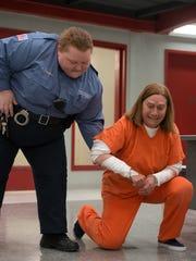 "Dale Soules (right) in a scene from Season 6 of ""Orange"