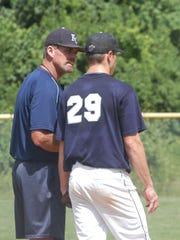 Kentucky Colonels and St. Henry head coach Walt Terrell talks to pitcher Zach Wise (Carroll County) during the Kentucky Colonels' 10-4 win in their opening game of their annual home tournament June 17 at St. Henry.