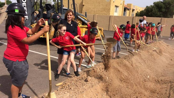 Kids from the Madison School District help break ground on a performing-arts center outside the district office on Tuesday, April 25, 2017.