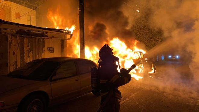 Fire engulfs a car and garage in the 500 block of Pennsylvania Avenue.