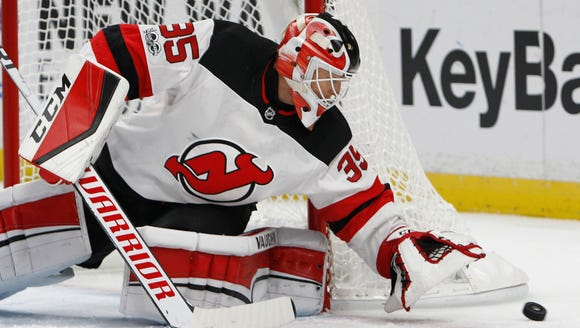 New Jersey Devils goalie Cory Schneider (35) covers