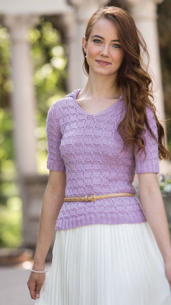 Teola is a polo-collared short-sleeve pullover with a textured fabric, great for spring or fall or a cool summer day.