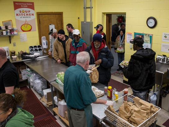 Volunteers at the Muncie Soup Kitchen prepare a Christmas
