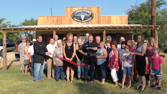 Laurie and Scott Deckers celebrate the grand opening of Longhorn Coffee Co. with family and friends on Aug. 4 at 4465 Christoval Road.