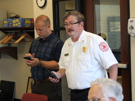 Marshfield Police Chief Rick Gramza, left, and Fire