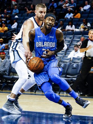 The Grizzlies' Chandler Parsons (left) knocks the ball away from the Magic's Terrence Ross (right) during a game in early October. Parsons will come off the bench this season as he returns from knee surgery.