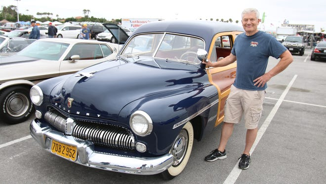 Scott Couchman and his 1949 Mercury station wagon at the Cars and Coffee car gathering in Costa Mesa, Calif.