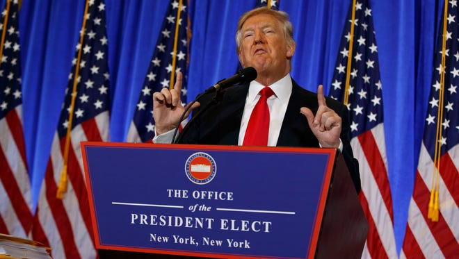 President-elect Donald Trump speaks during a news conference in the lobby of Trump Tower in New York on Wednesday.