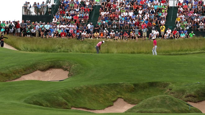Brooks Koepka finishes putting out on the bunker heavy hole 15 during round 3 of the 2017 U.S. Open Championship at Erin Hills.