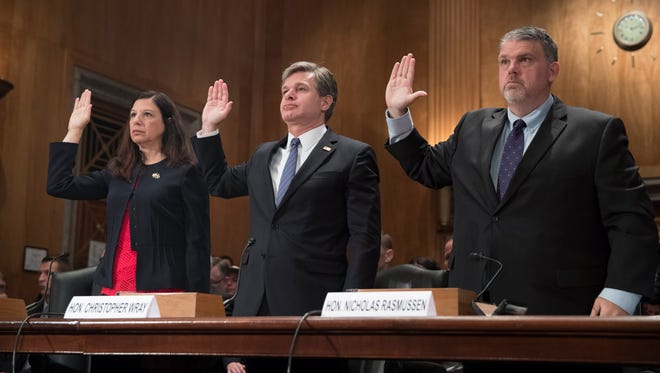 Acting Homeland Security Secretary Elaine Duke,  FBI Director Christopher Wray, and Director of the National Counterterrorism Center Nicholas Rasmussen are sworn-in to testify before the Senate Homeland Security and Governmental Affairs Committee hearing on 'Threats to the Homeland', on Capitol Hill in Washington, DC, USA, 27 September 2017.