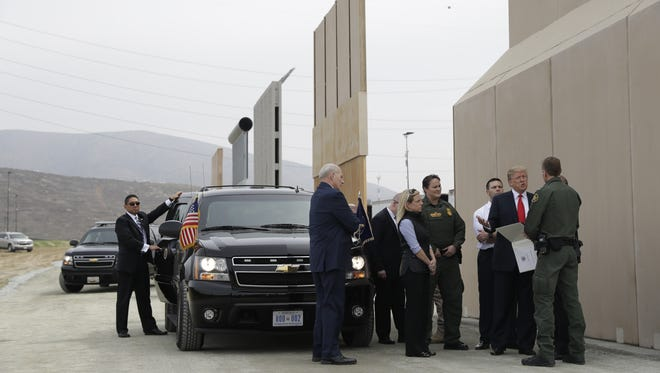 President Donald Trump reviews border-wall prototypes, Tuesday, March 13, 2018, in San Diego.