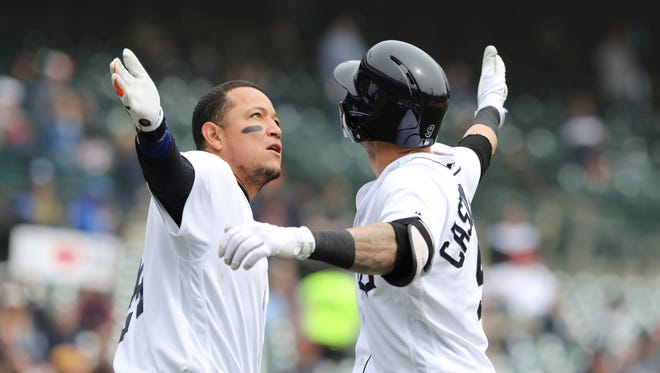 Nicholas Castellanos, right, is congratulated by Miguel Cabrera after they both scored on Castellanos' two-run home run during the third inning against the Royals on Saturday at Comerica Park.