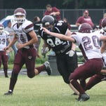 Ben Brown brings some heat from the blind side against Mayville quarterback Cole Coutcher.