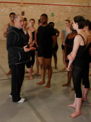 David Dorfman, left, talks to University of Louisiana at Lafayette dance majors at McLaurin Gym Wednesday.