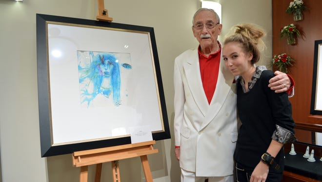 Pierre Henri Matisse poses for a photo with Rosa Keck, 12, of Appleton. Matisse invited Keck to display some of her artwork alongside his at Studio 247 Fine Jewelry in Grand Chute, Wis., on May 21, 2016.