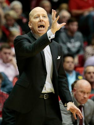 Cincinnati Bearcats head coach Mick Cronin directs his offense in the second half of the NCAA basketball game between the Cincinnati Bearcats and the Samford Bulldogs at Fifth Third Arena on UC's campus  in Cincinnati on Wednesday, Nov. 23, 2016. The Bearcats rallied in the second half for a 70-55 win over the Bulldogs.