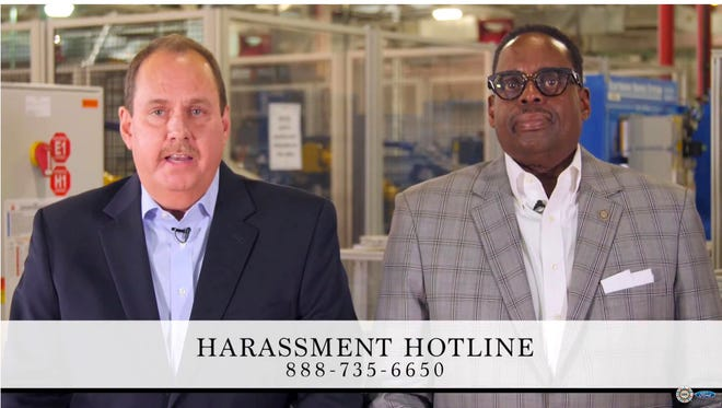 From left, Bruce Hettle, Group Vice President, Manufacturing and Labor Affairs, Ford and Jimmy Settles, Vice President, UAW-Ford, in a frame grab from a video talking about how to report harassment at plants for Ford in December 2017.