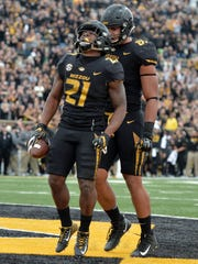 Missouri Tigers running back Ish Witter celebrates with tight end Albert Okwuegbunam after scoring during the first half against the Florida Gators at Faurot Field.