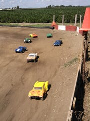 Radio-controlled off-road trucks prepare for the starting