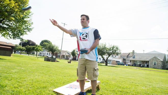 Mike Rabine plays a round of cornhole at Moul Field in Hanover Borough on June 7, 2018. Rabine founded the York Adams Cornhole league in 2016.