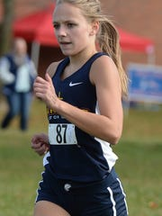 Seton's Jenna Barker runs in the cross country sectional race in Connersville, Saturday, Oct. 11, 2014.