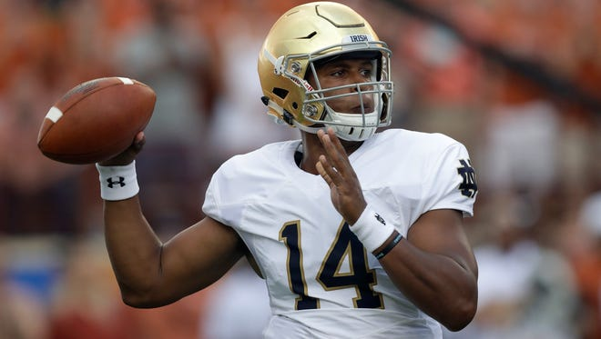 FILE -- Notre Dame quarterback DeShone Kizer throws a pass during the first half of an NCAA college football game against Texas, Sunday, Sept. 4, 2016, in Austin, Texas. (AP Photo/Eric Gay)